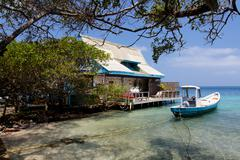 Caribbean House and Boat - stock photo