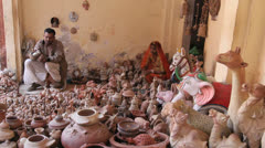 India Rajasthan Fort Pokaran potter and sculpted animals  Stock Footage