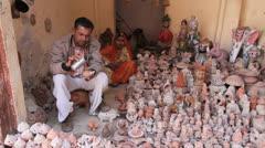 India Rajasthan Fort Pokaran potter drinks from teapot  Stock Footage