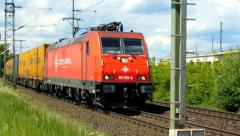 Cologne - circa may 2013 - Freight train with many cargo containers Stock Footage