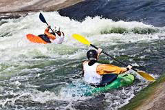 Two active kayakers Stock Photos