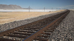 High desert, lonley railroad heads for the horizon - two, 1011  Stock Footage