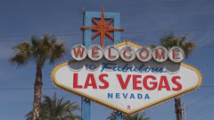 Welcome sign Las Vegas day Nevada USA America fabulous palm tree blue sky party Stock Footage