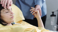 Man does caresses and holds the hand to his wife in hospital Stock Footage