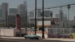USA Los Angeles scenic downtown with 1960's car and motel Stock Footage
