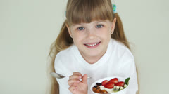 Cute girl holds plate with yogurt Stock Footage