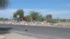 India Rajasthan purple bus passes on rubble lined road 7 Stock Footage
