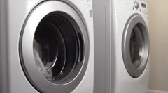 Laundry in Energy Efficient Machines Stock Footage