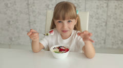 Sweet girl eating ice cream and smiling Stock Footage