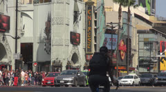Hollywood Boulevard traffic day Los Angeles California USA emblem people travel Stock Footage