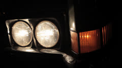 Switch off the lights of a 1969 Cadillac Stock Footage
