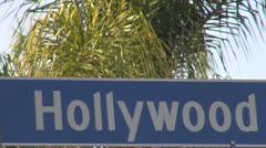 Hollywood Boulevard sign with palm tree by day, Los Angeles, California, USA - stock footage