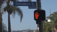 Stock Video Footage of Hollywood sign, Hollywood Boulevard sign with traffic light by day, palm tree