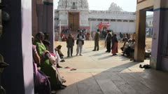 India Rajasthan Pushkar Rangji temple visitors in square  Stock Footage