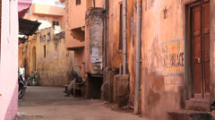 India Rajasthan Pushkar rustic alley and palace sign  Stock Footage