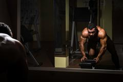 Male bodybuilder doing heavy weight exercise for back Stock Photos