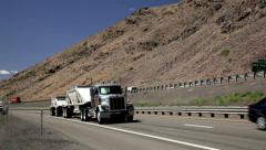 Semi-trucks, 18 wheeler traffic drive up hill, down hill,1016  Stock Footage