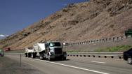 Stock Video Footage of 1016 - 18 wheeler traffic up hill, down hill