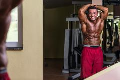 body builder showing abs - stock photo