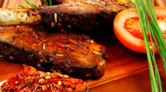 Savory plate on wood : grilled ribs on plate Stock Footage