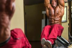 body builder doing abs exercise - stock photo