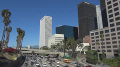 Aerial view bu highway traffic downtown Los Angeles day LA California US iconic  - stock footage