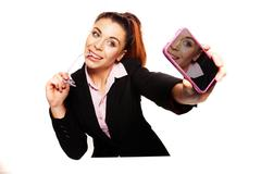 sexy businesswoman smiles for her self-portrait - stock photo