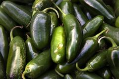 Green jalapeno chili peppers Stock Photos