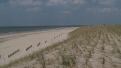Soft seawall or artificial dunes at North Sea beach Stock Footage