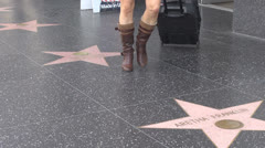 Tourists passing on Walk of fame by day, Hollywood Boulevard, Los Angeles, USA Stock Footage