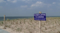Sign in dunes - no trespassing, dune plants in growth Stock Footage