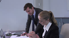 Man and woman working in an office Stock Footage