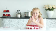 Stock Video Footage of Girl getting ready to eat strawberry cake