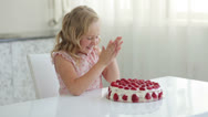 Stock Video Footage of Sweet little girl getting ready to eat a strawberry cake