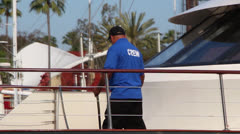 Boat Crewman Washing Deck Stock Footage