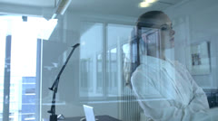 View of a businesswoman through a glass partition Stock Footage