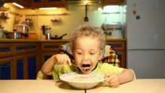 Boy eats soup itself Stock Footage