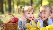Children in autumn park. dolly shot Stock Footage