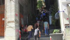 People walking up to Istiklal Street Stock Footage