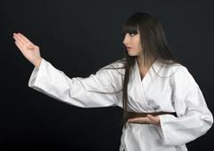 karateka asian girl on black background studio shot - stock photo