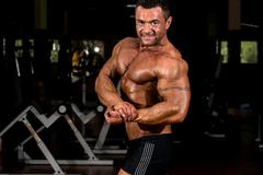 Stock Photo of muscular bodybuilder showing his side chest