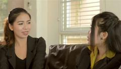 young asian office workers chatting and discussing work - stock footage