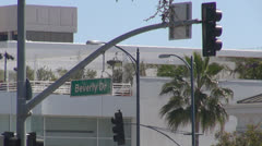Beverly drive sign, Santa Monica Boulevard with traffic light by day, LA, USA Stock Footage