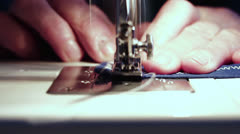 sewing machine -  seamstress - sew a dress in a textile factory - stock footage