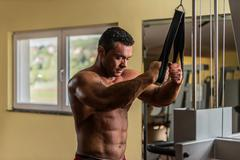 shirtless bodybuilder preparing for his exercise - stock photo