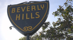 Beverly Hills sign with tree by day, Hollywood, Los Angeles, LA, California - stock footage