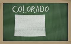 Stock Illustration of outline map of colorado on blackboard
