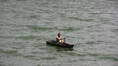 Fisherman on a Dugout Boat Stock Footage