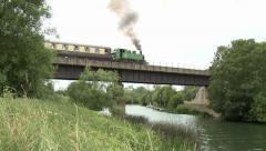 Steam Train Passing Over the River Avon Stock Footage