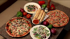 Pizza dinner with salad & breadsticks, static shot Stock Footage